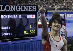 Kohei Uchimura of Japan celebrates his first-place finish in the men's all-around competition at the world gymnastics championship in London on Thursday.