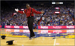 Kansas point guard Sharron Collins performs a dance during the Jayhawks' opening ceremonies at Allen Fieldhouse in Lawrence, Kan.