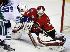 Calgary Flames goalie Miikka Kiprusoff makes the save on a shot by Vancouver Canucks' Steve Bernier during the second period. Kiprusoff had 26 saves in the game, and the Flames ended a three-game winless streak.