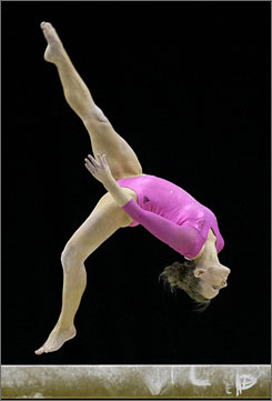American Bridget Sloan, who won the gold medal, competes in the beam phase of the all-around competition at the world championships in London.
