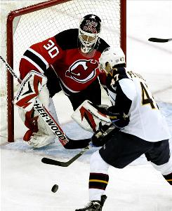 New Jersey Devils goalie Martin Brodeur looks to make a save on a shot by the Atlanta Thrashers' Rich Peverley during the first period. Though Brodeur stopped 15 Atlanta shots, Peverley scored two goals in Atlanta's 4-2 win.