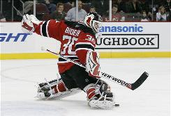 New Jersey Devils goalie Martin Brodeur made 26 saves against the Carolina Hurricanes on Saturday to move within one shutout of tying the NHL career record held by Terry Sawchuk.