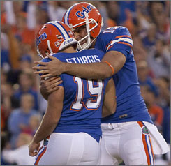 Florida kicker Caleb Sturgis (19) is embraced by teammate Chas Henry after kicking the game-winning field goal against Arkansas.
