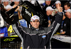 Jimmie Johnson celebrates in Lowe's Motor Speedway's victory lane after his sixth win at the 1.5-mile track.