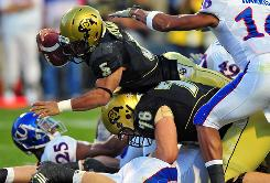 Colorado Buffaloes running back Rodney Stewart, No. 5, dives for a 4-yard touchdown against the Kansas Jayhawks in the first half at Folsom Field. Colorado pulled off the upset 34-30.