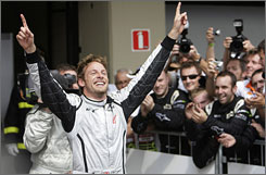 Brawn GP's Jenson Button is greeted by well-wishers after securing his first world championship with a fifth-place finish in Brazil.