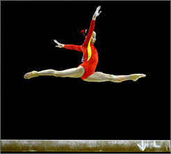 Linlin Deng of China performs on her way to a world title on balance beam.