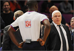 Maccabi Tel Aviv head coach Pini Gershon stands his ground after being whistled for his second technical foul in an exhibition loss to the Knicks.