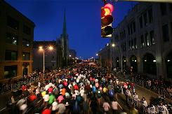 Runners make their way down Fort Street at the start of the Detroit Free Press/Flagstar Marathon in Detroit on Sunday.