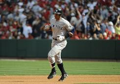 The Yankees' Alex Rodriguez rounds the bases after hitting a solo homer in the fourth inning of New York's 11-inning, 5-4 loss to the Los Angeles Angels.