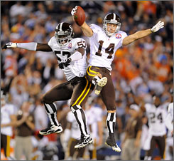 A 5-yard touchdown by Brandon Stokley, right, iced the Broncos' 34-23 win on Monday.