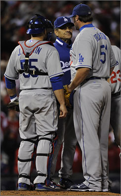 Dodgers' Jonathan Broxton, right, gave up the game-winning two-run double to Phillies' Jimmy Rollins in the ninth inning to blow the save in Game 4 of the NLCS.