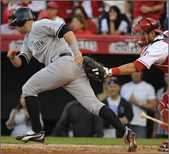 Angels catcher Jeff Mathis tags out Yankees pinch-hitter Francisco Cervelli after a dropped third strike in the 11th inning. Cervelli was batting for closer Mariano Rivera, who pitched in the 10th inning.