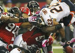 Chicago running back Matt Forte is stopped on the goal line by Atlanta defenders during their Sunday night game.