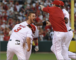 Angels teammates mob Jeff Mathis after his game-winning hit in the bottom of the 11th inning against the Yankees in Game 3 of the ALCS.