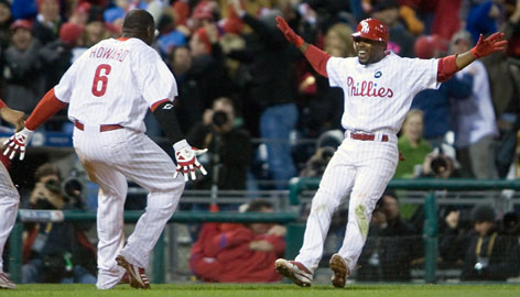Jimmy Rollins, right, is met by Ryan Howard after he hit a two-out, two-run double off Dodgers closer Jonathan Broxton to win Game 3 and take a 3-1 NLCS lead.