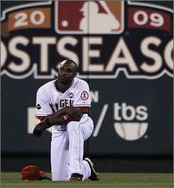 Angels center fielder Torii Hunter pauses during a pitching change in Tuesday's Game 4 of the American League Championship Series. The Yankees won 10-1.