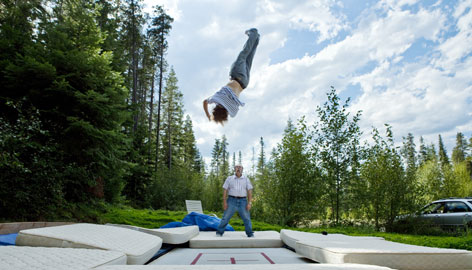 Patrick Deneen, the 2009 moguls world champion, spends some of his time practicing at his family's ranch in Washington State. Here he's spotted by his father as he uses a trampoline for elevation.