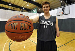 """Despite having only one hand, Kevin Laue earned a basketball scholarship at Manhattan. """"So many coaches take chances on kids with problem backgrounds. But because they're talented, and coaches feel they'll help them win, those guys get chances and sometimes even second chances. So why doesn't Kevin get  a  chance?"""" Manhattan coach Barry Rohrssen asks."""