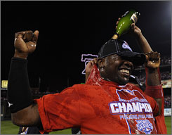 Phillies first baseman Ryan Howard is doused with champagne before accepting the NLCS MVP trophy.