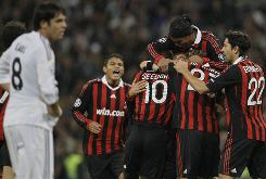Real Madrid's Kaka, left, laments an AC Milan goal while the Italian team celebrates Tuesday.