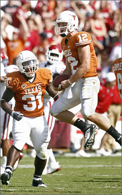 "Texas quarterback Colt McCoy, celebrating with teammate Cody Johnson (31) Saturday after the Longhorns defeated Oklahoma in the Red River Rivalry game, believes this season's team is ""a more mature team"" than last year's squad."