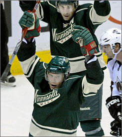 Minnesota Wild captain Mikko Koivu, foreground, celebrates his tying goal with teammate Andrew Brunette.