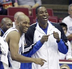 Vince Carter, left, is the biggest addition to the Magic for the 2009-10 season. Orlando, led by Dwight Howard, right, has underwent several changes following a 2008 campaign that ended with a 4-1 loss to the Lakers in the NBA Finals.