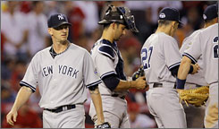 Yankees starting pitcher A.J. Burnett, left, exits Thursday night's game. He settled down after a bad first inning but then found trouble in the seventh inning of the defeat.
