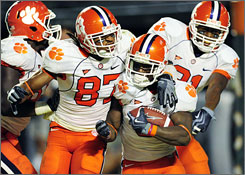 Clemson celebrates Jacoby Ford's touchdown in overtime that gave the Tigers a 40-37 victory over No. 9 Miami in overtime.