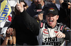 Timothy Peters waves the checkered flag after his first truck series victory at Martinsville Speedway.
