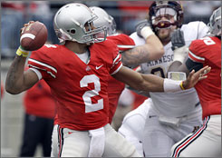 Terrelle Pryor threw two touchdowns and ran for another as No. 17 Ohio State shut down Minnesota for a 38-7 triumph.