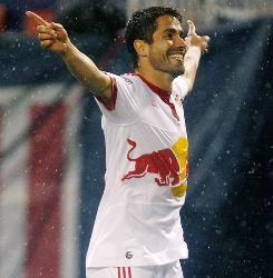 Juan Pablo Angel celebrates after scoring a goal in the first half Saturday.