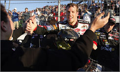 Brad Keselowski celebrates with his crew after notching his first victory at Memphis Motorsports Park.