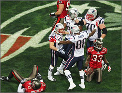 Patriots players celebrate during their 35-7 defeat of the Bucs on Sunday.