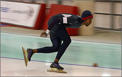 Shani Davis skates in the 10,000 meter competition during the Olympic Qualifying event in Milwaukee.