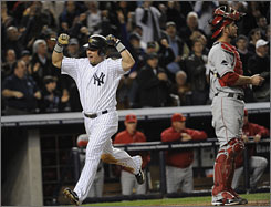 The Yankees' Nick Swisher scores in the fourth inning to put New York up 2-1.