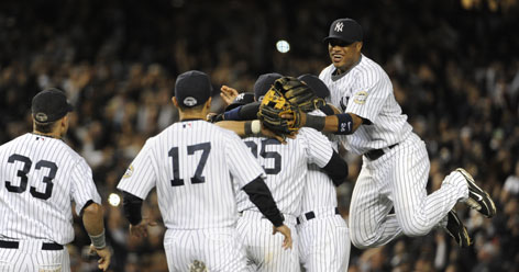 Yankees second baseman Robinson Cano, right, celebrates with his teammates after New York's win over the Angels.