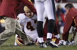 Washington Redskins tight end Chris Cooley sits on the ground after receiving an injury during the second quarter of the Redskins' game against the Philadelphia Eagles in Landover, Md. Cooley broke his ankle.