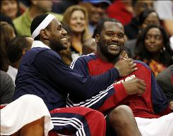 The Cavaliers are hoping that LeBron James, left, and Shaquille O'Neal will form a championship duo that brings Cleveland its first title in a major sport since 1964.