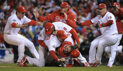Catcher Carlos Ruiz is on the bottom and reliever Brad Lidge is on top of him as the Phillies celebrate after defeating the Rays. In the last 87 years, the only NL team to repeat as World Series champs are the Reds.