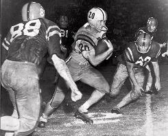 LSU's Billy Cannon, center, at the start of his 89-yard punt return for a touchdown Nov. 1, 1959, against Mississippi. Led by Cannon, who won the Heisman Trophy that season, the Tigers prevailed 7-3 and handed the Rebels their only loss.