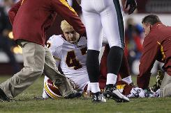 Washington Redskins tight end Chris Cooley sits on the ground after injuring his ankle during the second quarter of the team's game against the Philadelphia Eagles, Monday in Landover, Md. Cooley underwent surgery Wednesday and could return to action in a month.