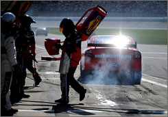 The Department of Energy says it would prefer NASCAR change the gas in cans such as this one at Kansas Speedway to a bio-based fuel.