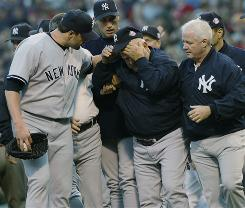 Members of the New York Yankees organization tend to coach Don Zimmer after his infamous altercation with Pedro Martinez, then of the Boston Red Sox, during the 2003 ALCS. Martinez said Wednesday that he regrets the incident.