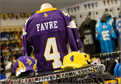 After 16 years in a Packers jersey, Brett Favre's name now graces the colors of the archrival Vikings in sports stores around Green Bay.