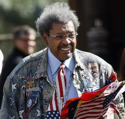 Don King arrives for a news conference Wednesday at the Treasure Island hotel-casino in Las Vegas.