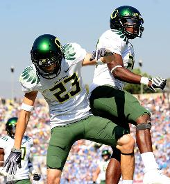 Oregon Ducks wide receiver Jeff Maehl (23) and running back Kenjon Barner celebrate a touchdown against the UCLA Bruins in the second half of their game at the Rose Bowl on Oct. 10. Oregon defeated UCLA 24-10. With a 6-1 overall record, they confidently welcome USC onto their home field.