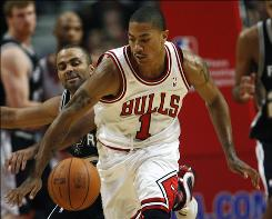 Chicago Bulls guard Derrick Rose and San Antonio Spurs guard Tony Parker chase after the ball during the first half in Chicago on Thursday. Rose had 13 points and seven assists in leading the Bulls to the upset victory over the Spurs.