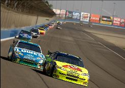 Mark Martin, driver of the #5 Kellogg's Chevrolet, leads Jimmie Johnson, driver of the #48 Lowe's Chevrolet, during the NASCAR Sprint Cup Series Pepsi 500 at Auto Club Speedway on Oct. 11 in Fontana, Calif.